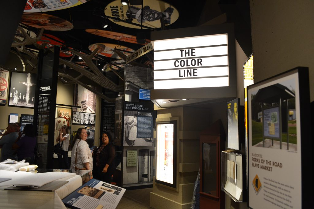 People look at exhibits within the Mississippi Civil Rights Museum. Photo by Rachel Ishee