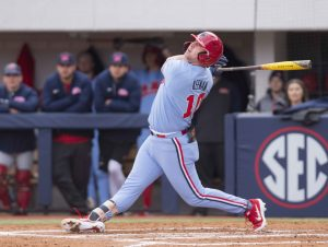 dcbf7be5c7d6 Ole Miss infielder Tyler Keenan watches the ball after hitting a double  during practice earlier this season. The Rebels will play the Florida Gators  at home ...
