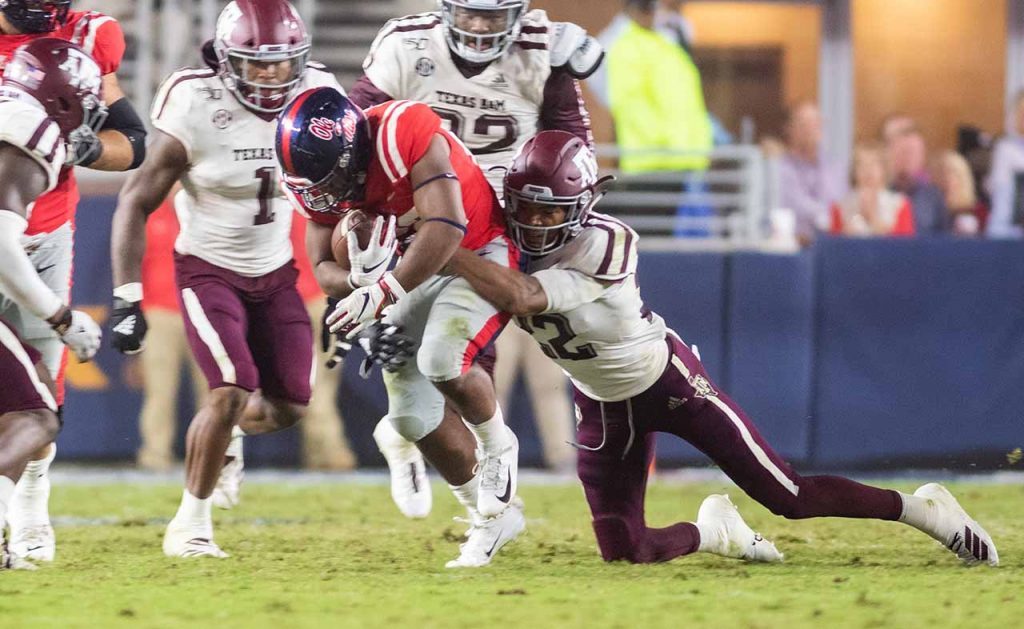 Rebels fall to Aggies in back-and-forth affair